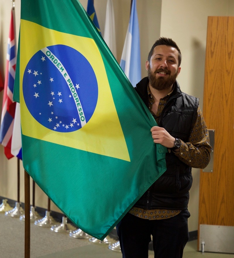 NWACC Student Holding a Brazilian Flag