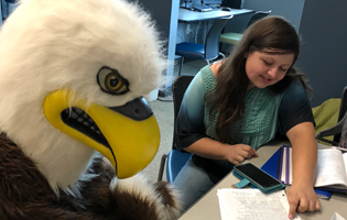 Eddie Eagle tutoring a female student