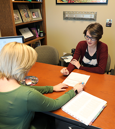 Female student talking to a female advisor.